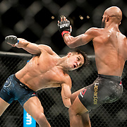 Henry Cejudo (blue trunks) becomes the UFC flyweight champion by beating Demetrious Johnson (black trunks) in a title bout at UFC 227 held at the Staples Center in Los Angeles on August 4, 2018. Photo by Todd Bigelow for ESPN.