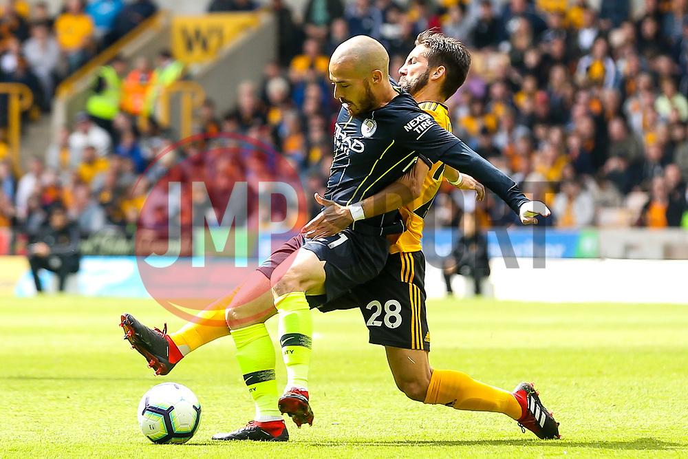 David Silva of Manchester City is tackled Joao Moutinho of Wolverhampton Wanderers - Mandatory by-line: Robbie Stephenson/JMP - 25/08/2018 - FOOTBALL - Molineux - Wolverhampton, England - Wolverhampton Wanderers v Manchester City - Premier League