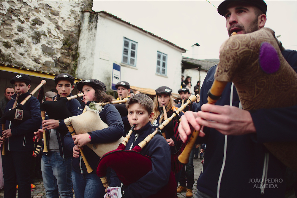 Shrovetide parade, with caretos doing tricks on the crowd along the way