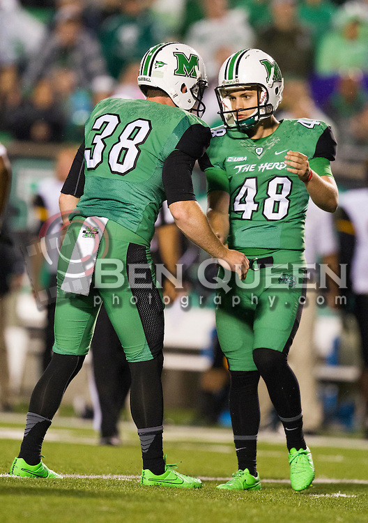 Oct 9, 2015; Huntington, WV, USA; Marshall Thundering Herd place kicker Nick Smith (48) celebrates with Marshall Thundering Herd punter Tyler Williams (38) after making a field goal during the second quarter against the Southern Miss Golden Eagles at Joan C. Edwards Stadium. Mandatory Credit: Ben Queen-USA TODAY Sports