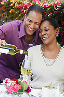 Man Pouring a Glass of Wine for His Wife