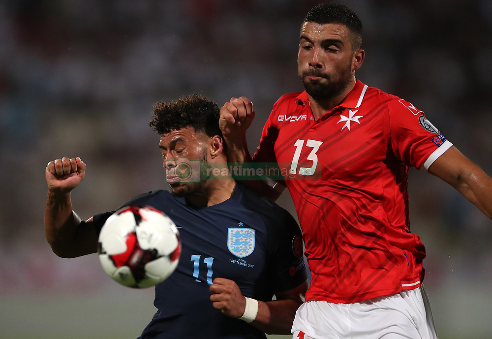 England's Alex Oxlade-Chamberlain and Malta's Zach Muscat battle for the ball during the 2018 FIFA World Cup Qualifying, Group F match at the National Stadium, Ta' Qali. PRESS ASSOCIATION Photo. Picture date: Friday September 1, 2017. See PA story SOCCER Malta. Photo credit should read: Nick Potts/PA Wire. RESTRICTIONS: Use subject to FA restrictions. Editorial use only. Commercial use only with prior written consent of the FA. No editing except cropping.