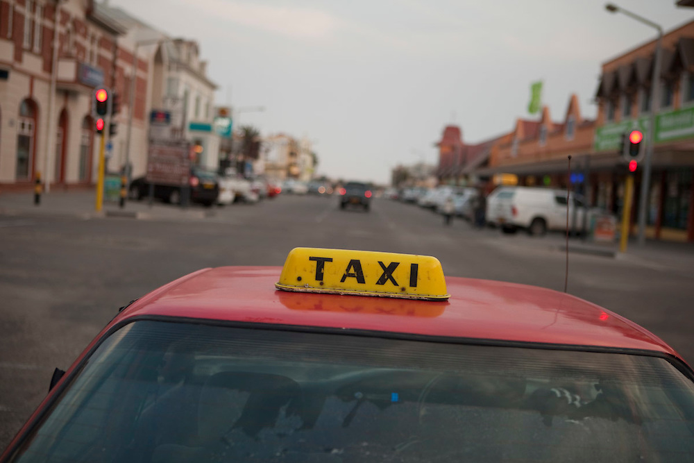 Taxi running through the streets of Swakopmund, Namibia.