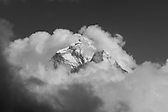 The summit of Ama Dablam rises above a sea of cloud, seen from the Thokla Pass at 4830 metres.