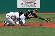 Kansas State's Byron Wiley (L) is safe a second base with a stolen base, as Missouri second basemen Brock Bond (R) tries to make a play on an errant throw in the bottom of the second inning at Tointon Stadium in  Manhattan, Kansas, April 7, 2007.  Kansas State lost to Missouri 3-0.