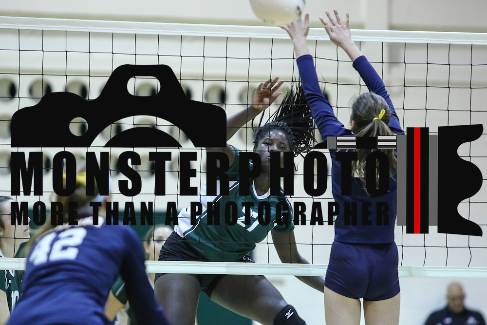 Zoe Akoto (27) spikes for the kill during the 2nd Round of the 2015 DIAA Girls Volleyball Tournament Saturday, Nov. 07, 2015 at Archmere Academy in Claymont.