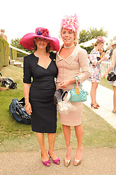 Left to right, LIZ HIGGINS and COZMO JENKS at the third day of the 2010 Glorious Goodwood racing festival at Goodwood Racecourse, Chichester, West Sussex on 29th July 2010.