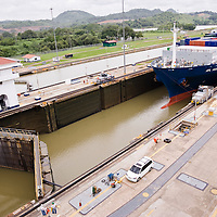 Cargo ship crossing the Panama Canal at Miraflores Locks, Panama City, Central America