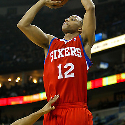 January 3, 2011; New Orleans, LA, USA; Philadelphia 76ers shooting guard Evan Turner (12) shoots against the New Orleans Hornets during the first quarter at the New Orleans Arena.   Mandatory Credit: Derick E. Hingle