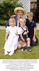 The COUNTESS OF MARCH with her twin children LADY ELOISE GORDON-LENNOX and LORD FREDDIE GORDON-LENNOX and her elder son LORD CHARLIE GORDON-LENNOX, at a luncheon in West Sussex on 14th July 2002.		PCB 86