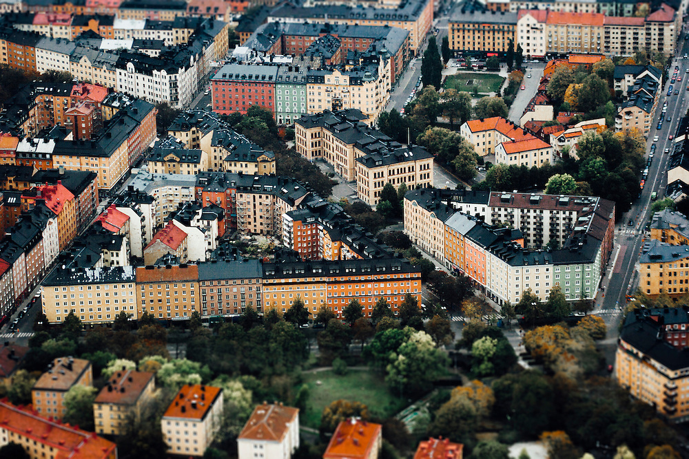 A view from a helicopter flying over  Stockholm, Sweden.  The house and street configuration forming a triangle.