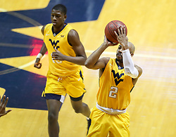 Feb 24, 2018; Morgantown, WV, USA; West Virginia Mountaineers guard Jevon Carter (2) shoots a jumper during the first half against the Iowa State Cyclones at WVU Coliseum. Mandatory Credit: Ben Queen-USA TODAY Sports