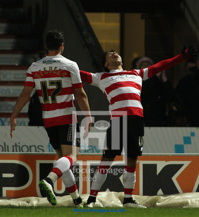 Harry Forrester (R) of Doncaster Rovers celebrates scoring the winning goal in the 1-0 win over Barnsley during the Sky Bet League 1 match at the Keepmoat Stadium, Doncaster<br /> Picture by Stephen Gaunt/Focus Images Ltd +447904 833202<br /> 17/01/2015