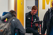 Liverpool Manager Jürgen Klopp reads outside the Liverpool dressing room ahead of the Premier League match between Wolverhampton Wanderers and Liverpool at Molineux, Wolverhampton, England on 23 January 2020.