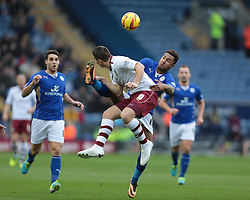 Burnley's Sam Vokes and Leicester City's Liam Moore in action  - Photo mandatory by-line: Nigel Pitts-Drake/JMP - Tel: Mobile: 07966 386802 14/12/2013 - SPORT - Football - Leicester - King Power Stadium - Leicester City v Burnley - Sky Bet Championship