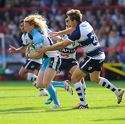 Bristol replacement Adrian Jarvis tackles Worcester Winger Tom Biggs  - Photo mandatory by-line: Joe Meredith/JMP - Mobile: 07966 386802 - 7/09/14 - SPORT - RUGBY - Bristol - Ashton Gate - Bristol Rugby v Worcester Warriors - The Rugby Championship
