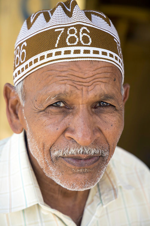 PUTTARPATHI, INDIA - 01st November 2019 - Portrait of a local to Puttarpathi standing for their photograph to be taken and looking directly at camera, Andhra Pradesh, South India.