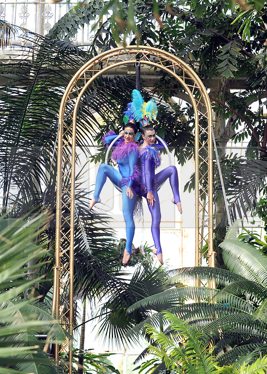 © under license to London News Pictures. LONDON, UK  10/05/2011. The Launch of Kew Gardens Summer Festival in West London, today (10/05/2010). Zahara O'Brien and Sophie Page-Hall (R) perform an acrobatic display, evoking tropical birds in the iconic Palm House. .Photo credit should read Stephen Simpson/LNP.