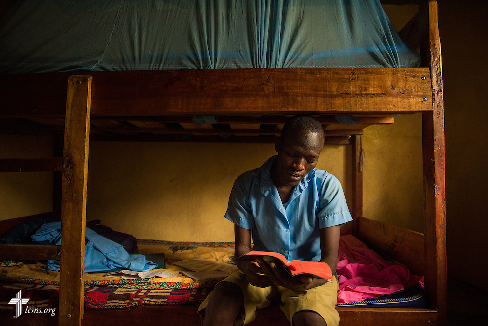Moses Lochul Rutale studies for his evening devotion from the Holy Gospel of Jesus Christ, according to Luke, in his dormitory bunk bed at the U-Dom ELCK (Evangelical Lutheran Church in Kenya) Project 24 site on Thursday, June 23, 2016, in Chepareria, Kenya.  LCMS Communications/Erik M. Lunsford