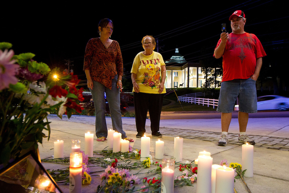 BRANSON, MO - APRIL 18: Dorthy Holtzclaw, Val Ladrigue, and Bobby Doucette, all of Branson, stand in front of flowers and candles placed on the ground during a candlelight vigil in honor of Dick Clark at Dick Clark's American Bandstand Theater on April 18, 2012 in Branson, Missouri.  (Photo by David Welker/Getty Images)*** Local Caption *** Dorthy Holtzclaw; Val Ladrigue; Bobby Doucette