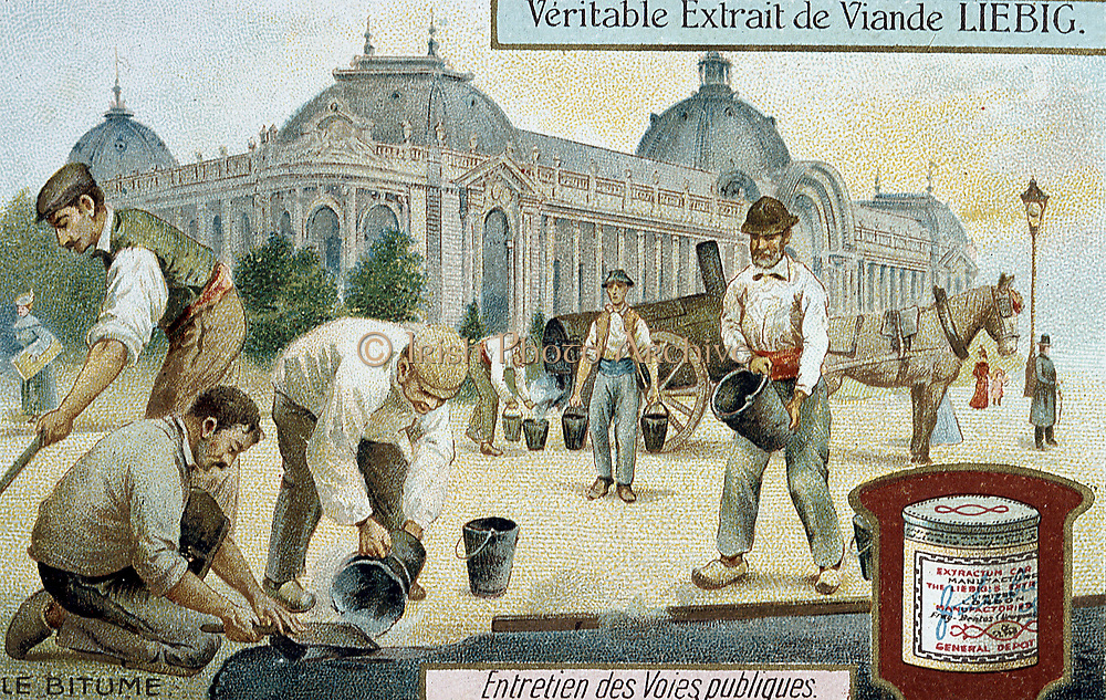 Laying bitumen road surface in a Paris street. In background man is drawing buckets of liquid bitumen from tanker for the workmen to spread. Men are wearing wooden shoes (sabots). Liebig trade card c1900. Chromolithograph.