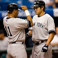 New York Yankees'  Johnny Damon, right, is welcomed at home plate by the Yankees' Gary Sheffield after Damon hit a grand slam off of Tampa Bay Devil Rays pitcher Dan Miceli during the eighth inning of their American League baseball game on Thursday, May 4, 2006 in St. Petersburg, Fla.(AP Photo/Scott Audette)