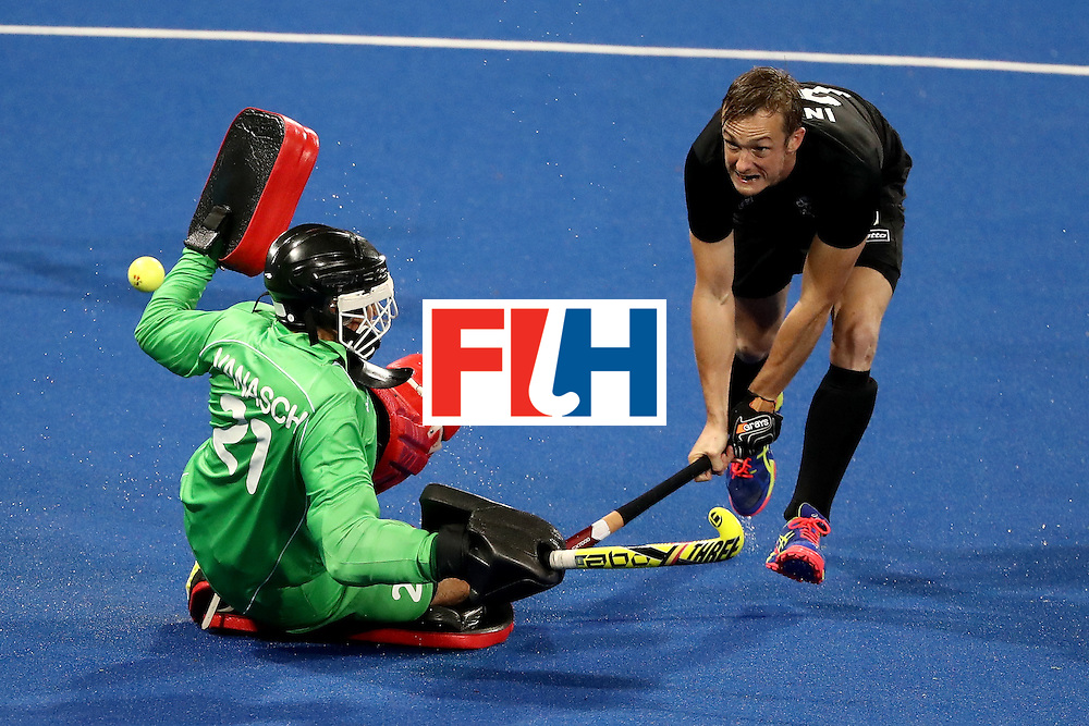 RIO DE JANEIRO, BRAZIL - AUGUST 12:  Vincent Vanasch #21 of Belgium  defends against Hugo Inglis #29 of New Zealand during a Men's Preliminary Pool B match on Day 7 of the Rio 2016 Olympic Games at the Olympic Hockey Centre on August 12, 2016 in Rio de Janeiro, Brazil.  (Photo by Sean M. Haffey/Getty Images)