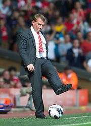 02.09.2012, Anfield, Liverpool, ENG, Premier League, FC Liverpool vs FC Arsenal, 2. Runde, im Bild Liverpool's manager Brendan Rodgers kicks the ball during the English Premier League 2nd round match between Liverpool FC and Arsenal FC at Anfield, Liverpool, Great Britain on 2012/09/02. EXPA Pictures © 2012, PhotoCredit: EXPA/ Propagandaphoto/ David Rawcliff..***** ATTENTION - OUT OF ENG, GBR, UK *****