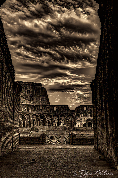 """Ominous clouds gather through the Arch of Colosseum - BW""…<br />