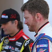 NASCAR Sprint Cup driver Dale Earnhardt Jr.(right) and driver Jeff Gordon is seen in the garage area, during a NASCAR Daytona 500 practice session at Daytona International Speedway on Wednesday, February 20, 2013 in Daytona Beach, Florida.  (AP Photo/Alex Menendez)