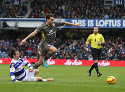 Leicester City's Matthew James gets booked for diving after this chalenge by Queen Park Rangers' Joey Barton - Photo mandatory by-line: Robin White/JMP - Tel: Mobile: 07966 386802 21/12/2013 - SPORT - FOOTBALL - Loftus Road - London - Queens Park Rangers v Leicester City - Sky Bet Championship