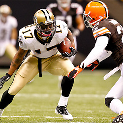 Oct 24, 2010; New Orleans, LA, USA; New Orleans Saints wide receiver Robert Meachem (17) is pursued by Cleveland Browns cornerback Eric Wright (21) during the second half at the Louisiana Superdome. The Browns defeated the Saints 30-17.  Mandatory Credit: Derick E. Hingle
