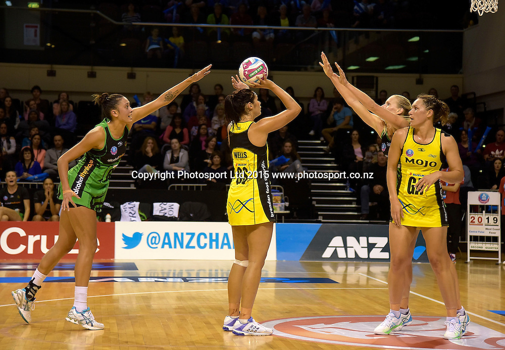 Pulse's Ameliaranne Wells (C takes a shot at goal with Fever's Erena Mikaere (L) and  April Letton (R in defense during the ANZ Championship - Pulse v Fever netball match at the TSB Arena in Wellington on Monday the 19th of April 2015. Photo by Marty Melville / www.Photosport.co.nz