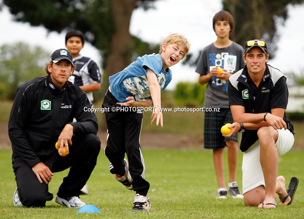 Jacob Oram and Tim Southee help coach Ryan Campbell (12) during the intermediate bowling practice during the National Bank Super Camp, a National Bank initiative to connect with cricket's grass roots. Held at the East Shirley Cricket Club, Christchurch, New Zealand. Thursday, 27 January 2011. Joseph Johnson / PHOTOSPORT.