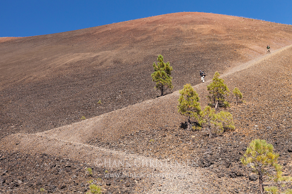 Two backpackers decend the steep southern trail of the Lassen Cinder Cone, Mt Lassen National Park.