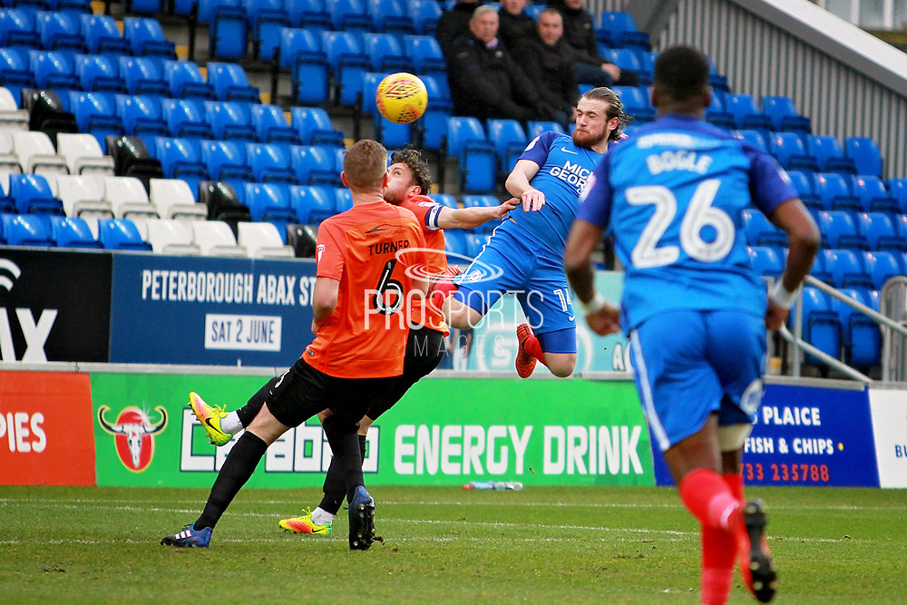 Peterborough United striker Jack Marriott (14) with a far post header during the EFL Sky Bet League 1 match between Peterborough United and Southend United at London Road, Peterborough, England on 3 February 2018. Picture by Nigel Cole.