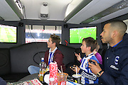 Liam Rosenior playing Fifa with Brighton fans on the Sky Bet 10 in 10 coach, on the way to the EFL Sky Bet Championship match between Birmingham City and Brighton and Hove Albion at St Andrews, Birmingham, England on 17 December 2016.