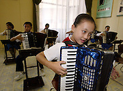 North Korean students play accordions during lessons in North Korea's capital Pyongyang. Photo by Lee Jae-Won (NORTH KOREA) www.leejaewonpix.com/