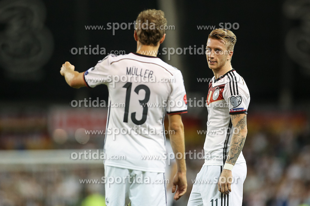 08.10.2015, Avia Stadium, Dublin, IRL, UEFA Euro Qualifikation, Irland vs Deutschland, Gruppe D, im Bild Marco Reus (Borussia Dortmund #11) und Thomas Mueller (Bayern Muenchen #13) // during the UEFA EURO 2016 qualifier group D match between Ireland and Germany at the Avia Stadium in Dublin, Ireland on 2015/10/08. EXPA Pictures &copy; 2015, PhotoCredit: EXPA/ Eibner-Pressefoto/ Risto Bozovic<br /> <br /> *****ATTENTION - OUT of GER*****