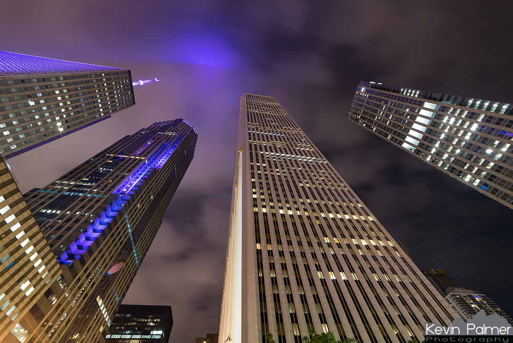 I liked this perspective standing at the base of the Aon Center, the 3rd tallest building in Chicago. A purple beam of light was illuminating the clouds above.