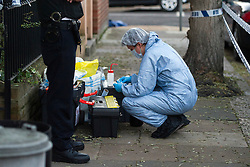 © London News Pictures. 11/11/2012. London, UK. Police forensics at the crime scene at a property on Hazlebury Road, Fulham, south west London, where the body of a 73-year-old man was discovered after a violent attack. A murder inquiry has been launched by police after the body of a  severely injured pensioner was found during a call-out to a burglary. Photo credit: Ben Cawthra/LNP