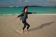 A young tourist on the beach of Espanola Island, Galapagos Archipelago - Ecuador. (fully released - 82010EXsP)
