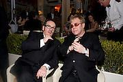 ELVIS COSTELLO; ELTON JOHN, Vanity Fair Oscar night party hosted by Graydon Carter.  Sunset  Tower Hotel, West Hollywood. 22 February 2009.