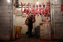 An ethnic Uighur butcher works in a meat stall in Urumqi city, Xinjiang Uighur Autonomous Province, China, 18 November 2017. Uighurs, a Muslim ethnic minority group in China, make up about 40 per cent of the 21.8 million people in Xinjiang, a vast, ethnically divided region that borders Pakistan, Afghanistan, Kazakhstan, Kyrgyzstan and Mongolia. Other ethnic minorities living in here include the Han Chinese, Kyrgyz, Mongolian and Tajiks people. Xinjiang has long been subjected to separatists unrests and violent terrorist attacks blamed by authorities on Islamist extremism while human rights groups say Chinese repression on religious rights, culture and freedom of movement caused undue tensions. Life however goes on under the watchful eye of the government for the ethnic Uighurs living in the city of Urumqi and surrounding areas and the region is still considered an attractive tourist spot. A recent report by state media Xinhua news agency claims Xinjiang received more than 100 million tourists in 2017, 'the highest figure in its history'.