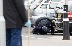 © Licensed to London News Pictures. 12/04/2017. LONDON, UK.  Police officers carrying out a search at the police cordon on Wager Street in Mile End in east London this morning. Police were called yesterday, 11th April at 16:46 to Wager Street in Tower Hamlets where a man was suffering from stabbing injuries. The 20 year old male victim was taken to hospital where he died shortly after.  This is the third young man stabbed to death in London in the last 24 hours. Photo credit: Vickie Flores/LNP