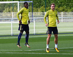 September 12, 2017 - Enfield, Greater London, United Kingdom - L-R Tottenham Hotspur's Serge Aurier and Tottenham Hotspur's Christian Eriksen.during a Tottenham Hotspur training session ahead of the UEFA Champions League Group H match against Borussia Dortmund  at Tottenham Hotspur Training centre on 12 Sept , 2017 in Enfield, England. (Credit Image: © Kieran Galvin/NurPhoto via ZUMA Press)