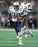 New England Patriots running back Corey Dillon rushes up field against the St. Louis Rams, early in the first quarter of the Patriots 40-22 win at the Edward Jones Dome in St. Louis Missouri, November 7, 2004.