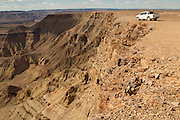 The Fish River Canyon spans below the Volkswagen 4X4 Amarok in Namibia. Image by Greg Beadle