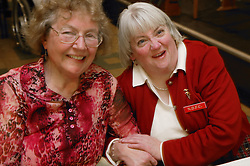 Two older women socialising at an event organised by Disability Friendship Club,