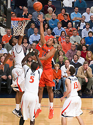 Virginia Tech forward Victor Davila (14) shoots over Virginia forward Jamil Tucker (12).  The Virginia Cavaliers defeated the Virginia Tech Hokies 75-61 at the John Paul Jones Arena on the Grounds of the University of Virginia in Charlottesville, VA on February 18, 2009.